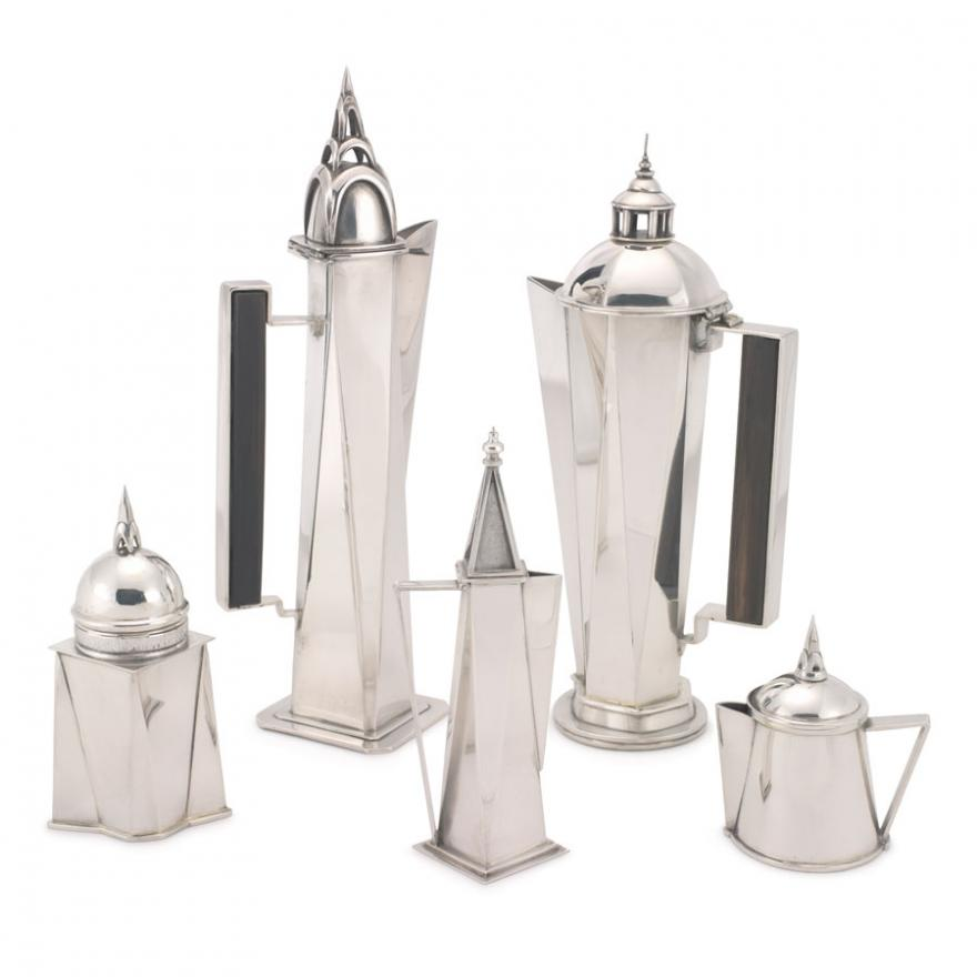 Five-piece angular tea or coffee service set made of silver. Includes four pitchers of varying sizes, and additional piece.