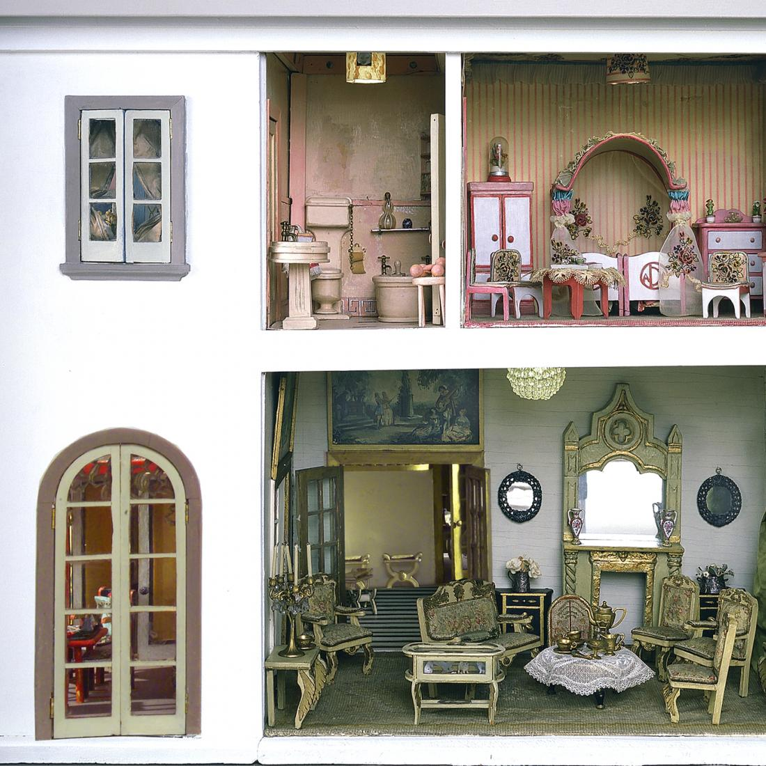 Right side view of the Stettheimer Dollhouse, showing three interior rooms.